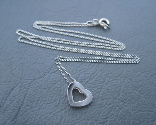 Sterling silver necklace with a small dimensional heart pendant