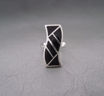 Long sterling silver wave ring with black onyx inlay