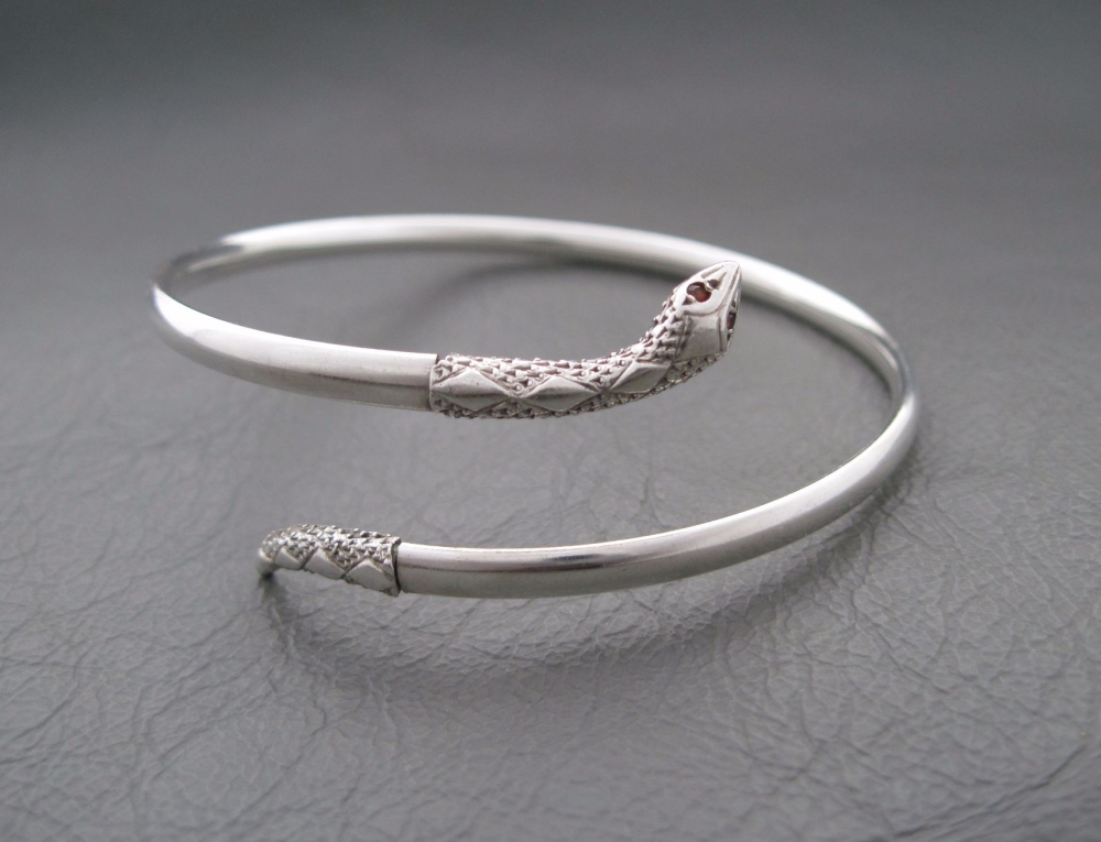 Vintage silver snake wrap bangle with garnet eyes