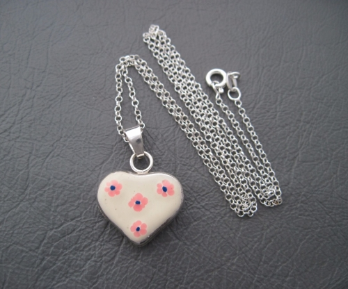 Sterling silver necklace with a floral cream enamel heart pendant