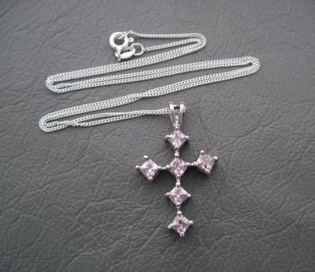 Sterling silver necklace with a pink stoned cross pendant