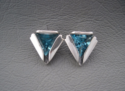 Sterling silver folded triangular earrings with blue stones