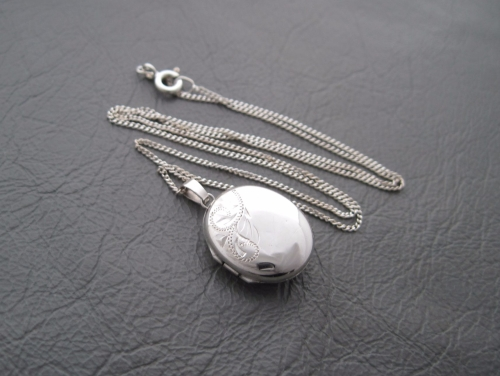 Vintage sterling silver necklace with an engraved oval locket