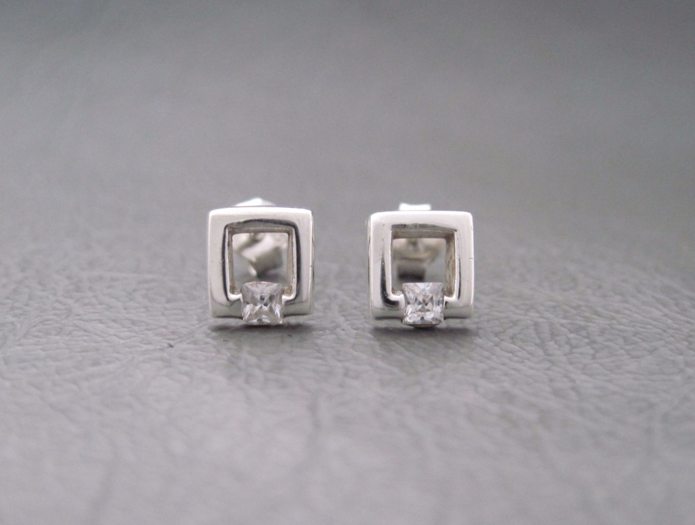 Sterling silver studs; small open stone set squares