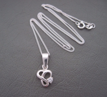 Sterling silver necklace with small fancy single stone pendant