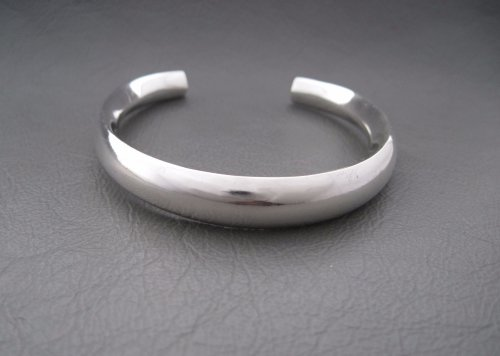 Modernist sterling silver child's rattle bracelet