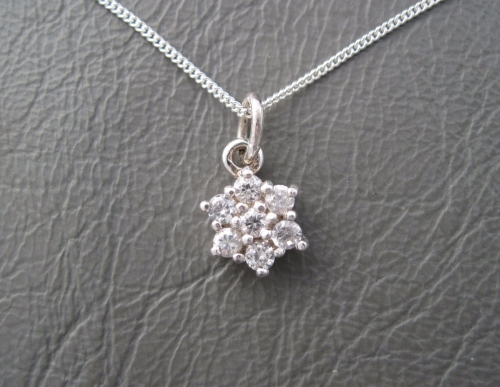 Sterling silver necklace with a clear daisy cluster pendant