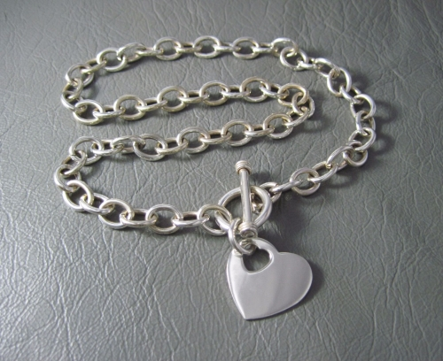Heavy sterling silver toggle necklace with a cut-out heart charm