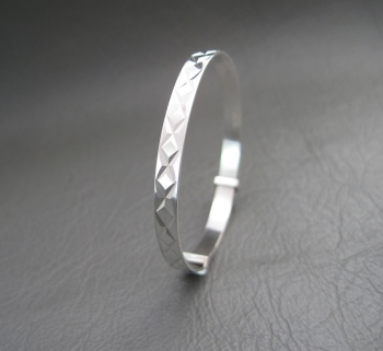 Vintage silver Christening bangle with a chased pattern