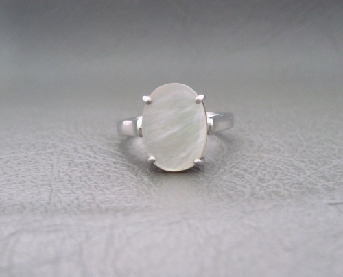 Sterling silver & Mother of Pearl ring with a fancy proud cup setting