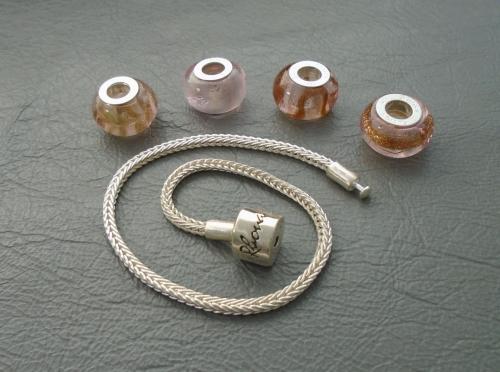 Sterling silver Rhona Sutton charm / bead bracelet