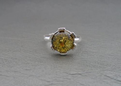 (NEW) Sterling silver ring with a circular green amber cabochon