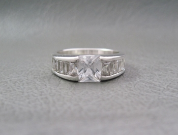 Sterling silver ring with a square stone feature & channel set shoulders