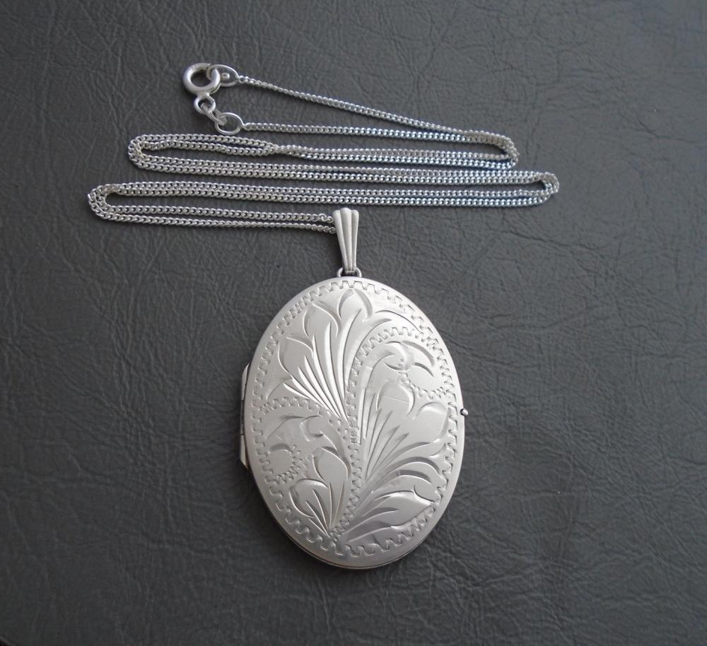 Large vintage sterling silver engraved locket