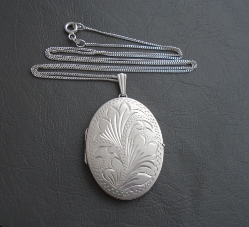 Large vintage sterling silver engraved locket