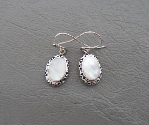 Fancy sterling silver framed Mother of Pearl earrings