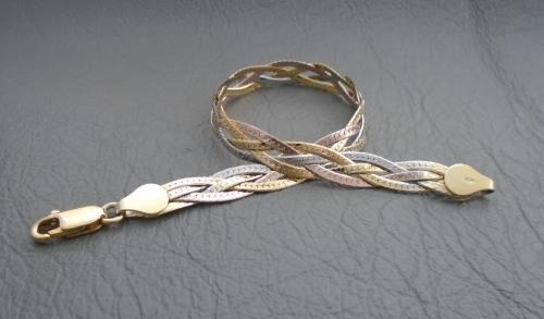 Sterling silver bracelet; plaited tri-colour
