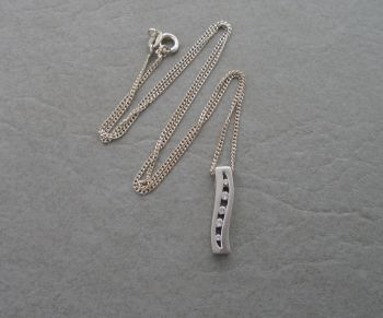Sterling silver necklace with a 5 graduated stone wave pendant