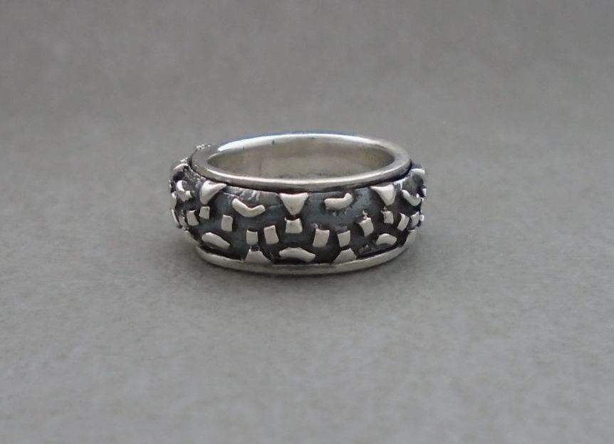 Heavily textured & oxidised sterling silver spinner ring