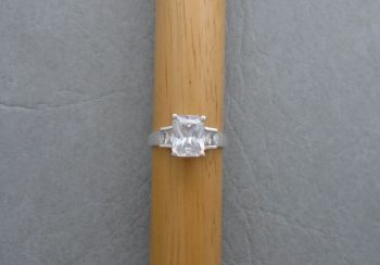 Rectangular sterling silver solitaire ring with accented shoulders