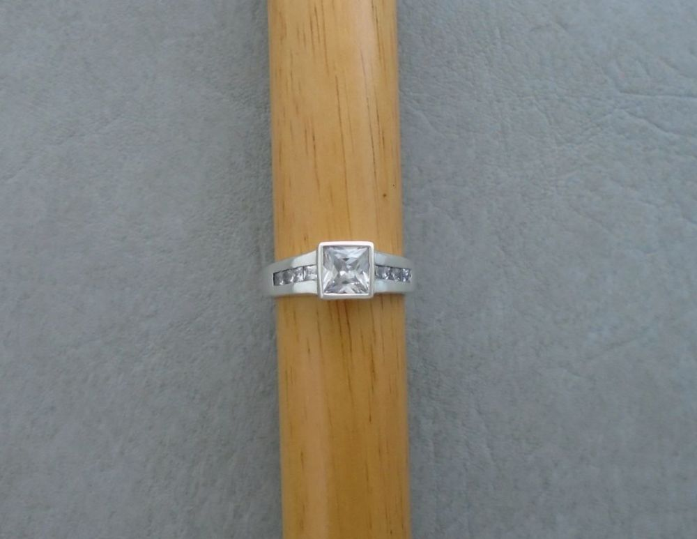 Sterling silver square stoned ring with accented shoulders