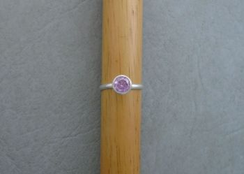 Proud set sterling silver & pink solitaire ring