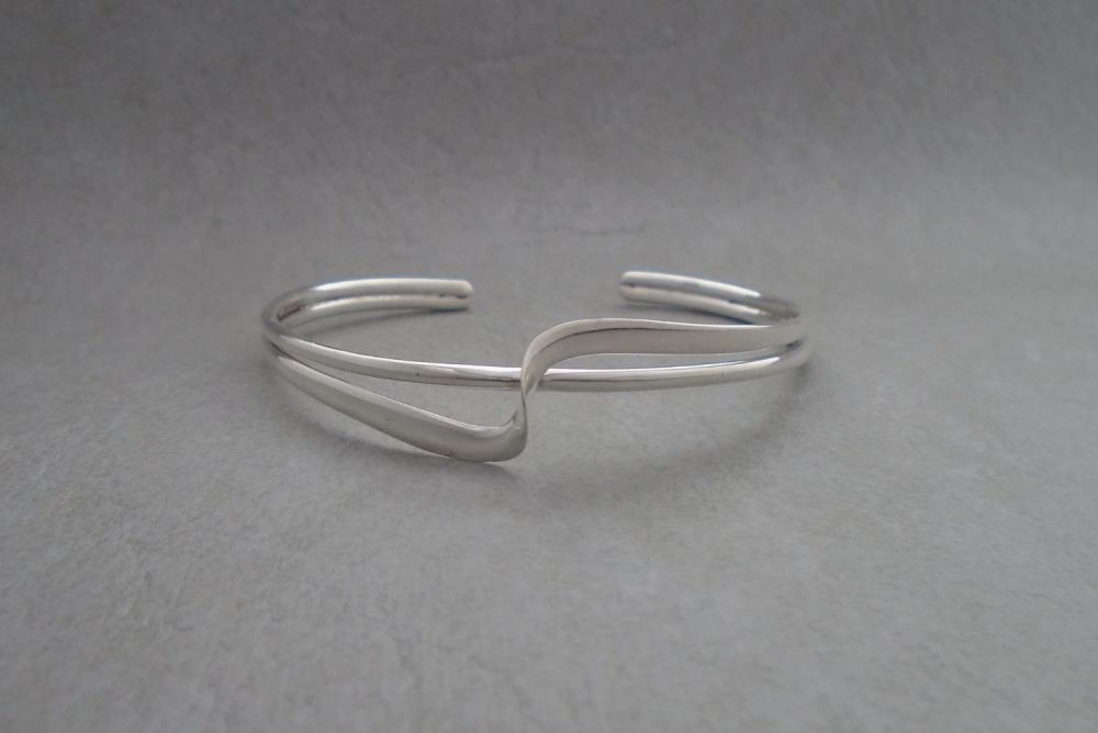 Double stranded sterling silver cuff with a twist