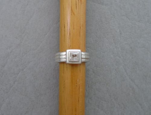 Chunky sterling silver trio band effect square solitaire ring