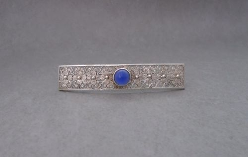 Vintage 835 silver filigree bar brooch with blue glass