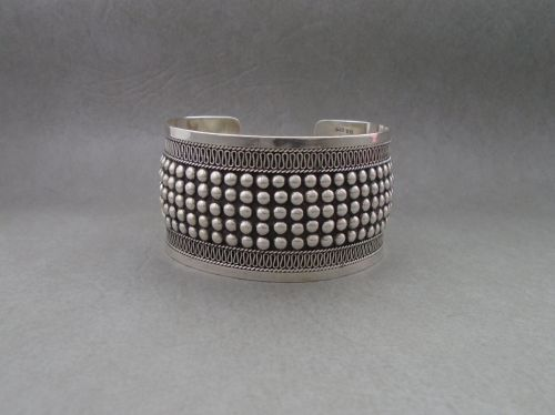 Heavy, wide sterling silver cuff with oxidised beaded detail
