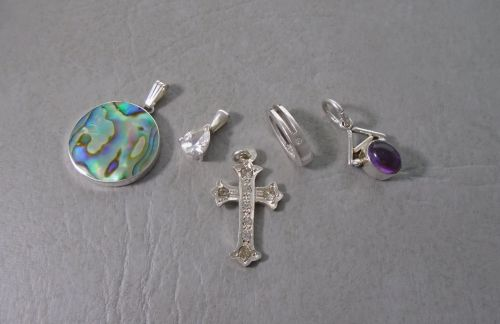 5 mixed sterling silver pendants