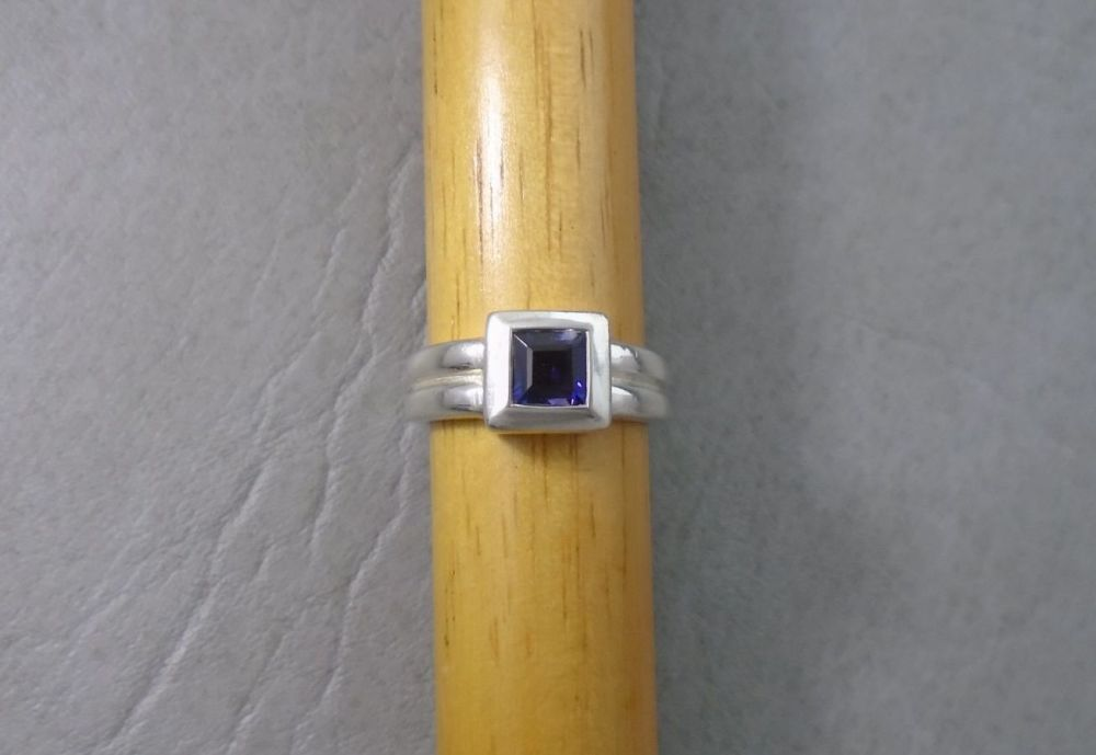 Sterling silver square set purple glass ring