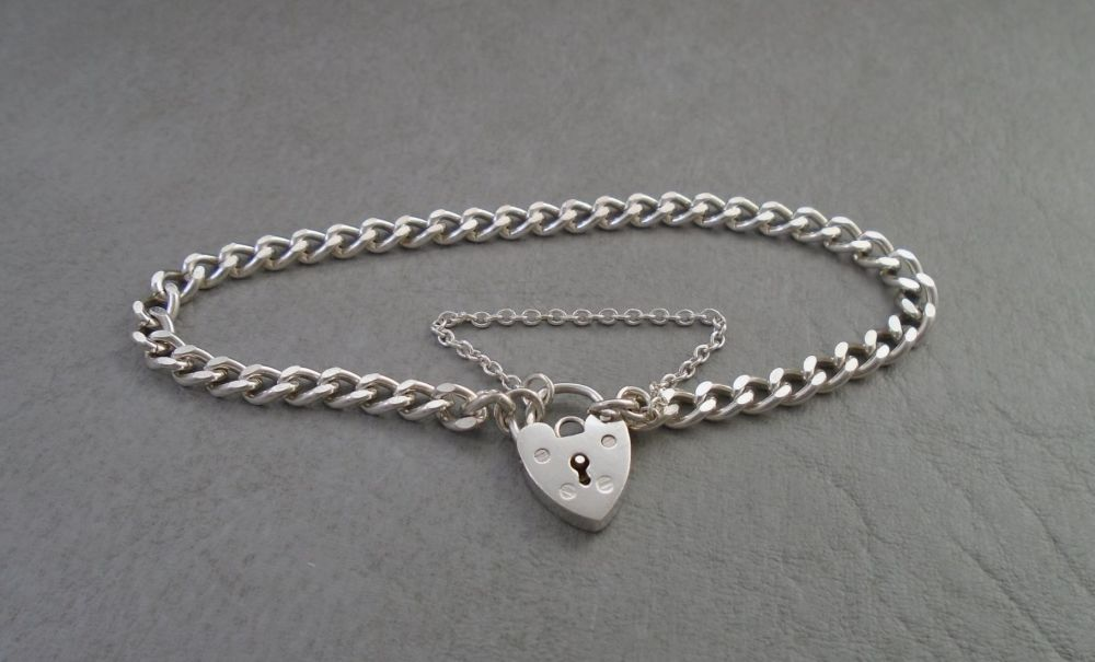 Vintage sterling silver charm bracelet with padlock & safety chain