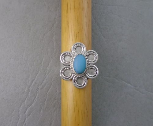 Chunky floral sterling silver ring with a greyish-blue stone