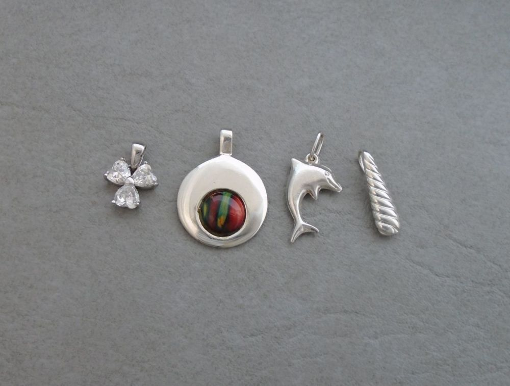 4 sterling silver pendants