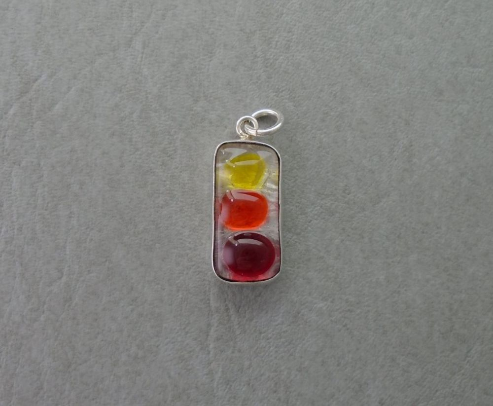 Sterling silver pendant with yellow, orange & red glass