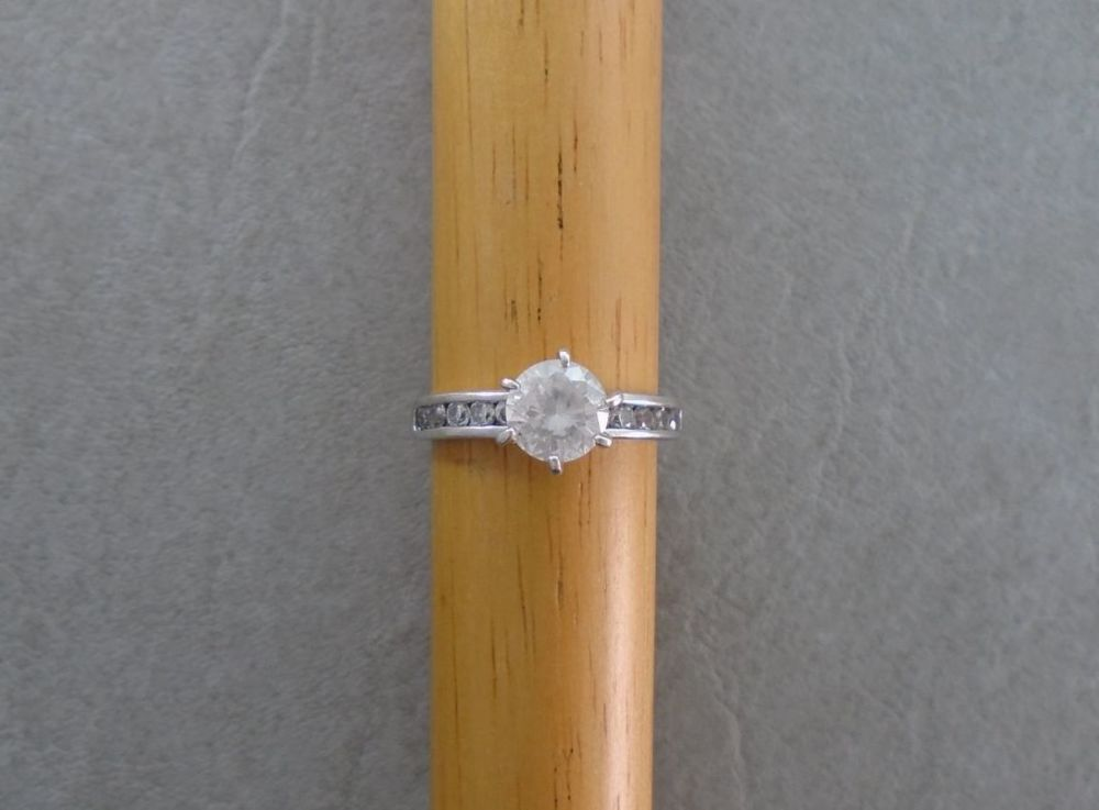 Proud set sterling silver solitaire ring with accented shoulders