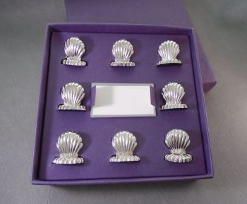 Box set of 8 silver plated shell place holders