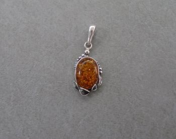 Small foliage framed sterling silver & amber pendant