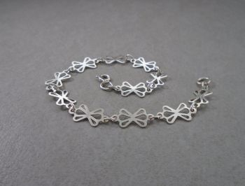 Sterling silver bracelet with fancy cut-out panels
