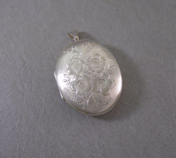 Large vintage sterling silver floral locket