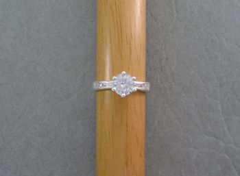 Sterling silver solitaire ring with stone accented shoulders