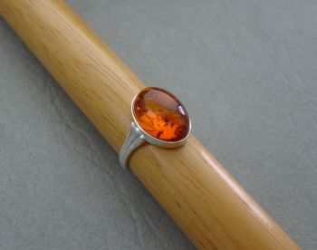Sterling silver & oval amber cabochon ring