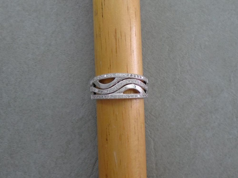 Sterling silver ring with dainty stones & wave detail