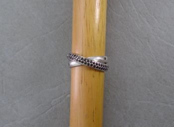 Sterling silver cross-over ring with black stones