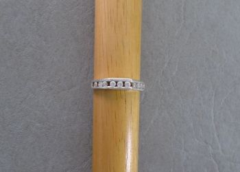 Sterling silver ring with an angled stone set feature