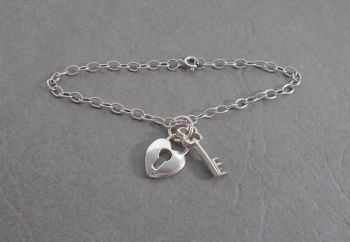 Sterling silver bracelet with lock & key charms