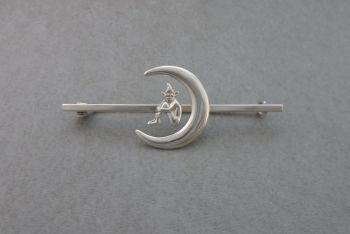 Sterling silver pixie in a moon brooch