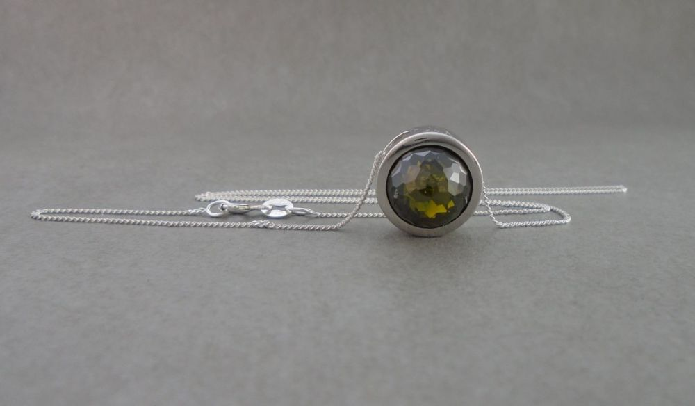Sterling silver necklace with a chunky faceted green dome pendant