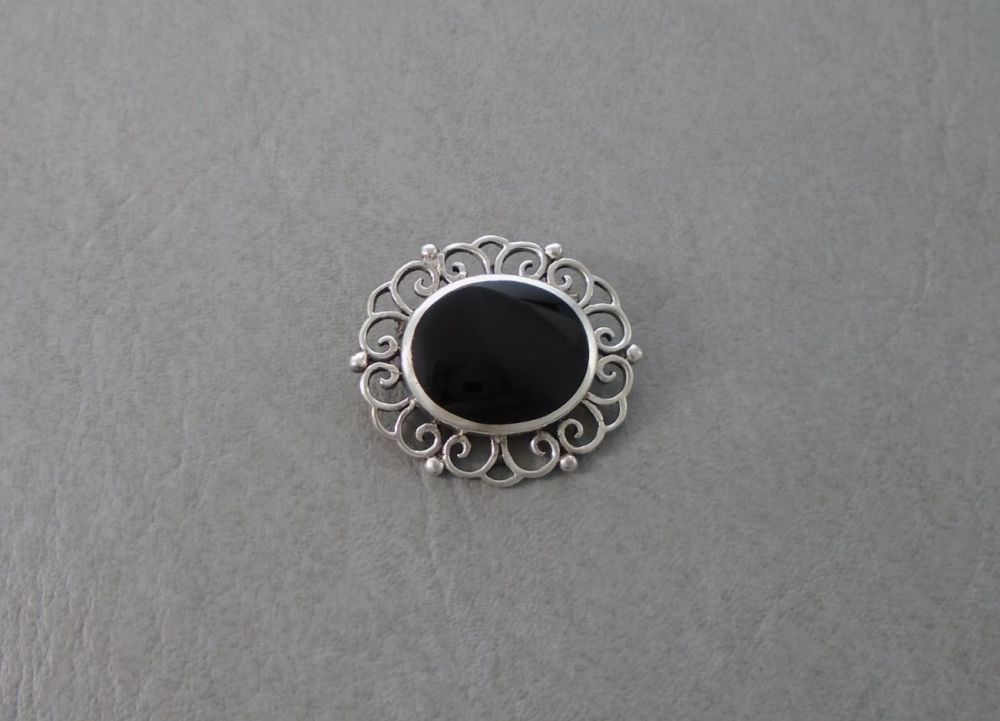 Sterling silver framed black onyx brooch